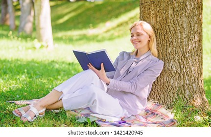 Self improvement and education concept. Female self improvement. Self improvement book. Business lady find minute to read book improve her knowledge. Girl lean on tree while relax in park sit grass.