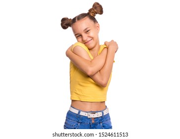 Self love and self care. Portrait of teen girl Hugging oneself, isolated on white background. Cute caucasian young teenager smiling. Happy funny child.
