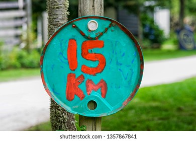 self made sign which indicates 15 km p.h.