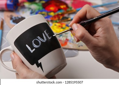 Self made Valentine's Day presents, DIY Craft Project, Woman decorating mug with acrylic painting