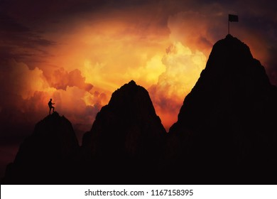 Self overcome as a businessman climbing graph shape mountain over the clouds for reaching the finish flag. Life is full of ups and downs concept. Difficult road to win and success.