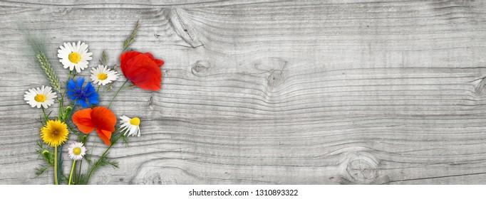 self picked summer flowers on grey wood