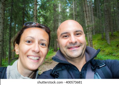 self portait of an happy couple in the woods