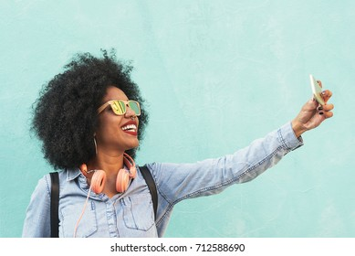 Self portrait of beautiful young afro american woman. Selfie Concept.