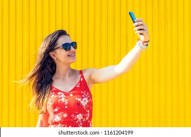 Self portrait of beautiful young woman. Selfie Concept
