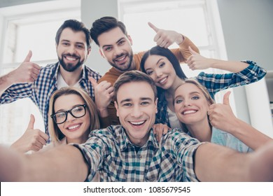 Self portrait of economists, students, financiers, lawyers in casual outfit showing thumb up with fingers shooting selfie on front camera with joyful cheerful expression having leisure, timeout