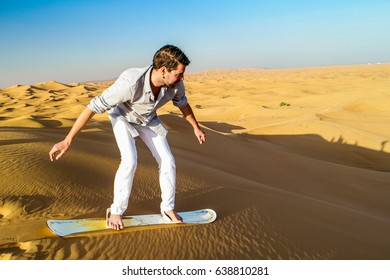 self portrait model man sandboarding in the dubai desert, sand boarding Dubai desert February 2017