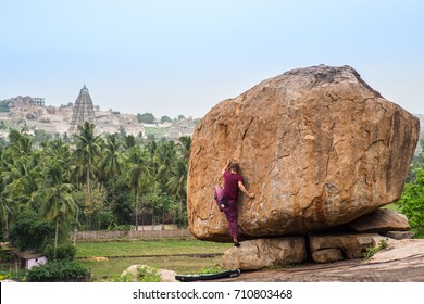 Self portrait of photographer bouldering in a tropical climate with temples in the background.