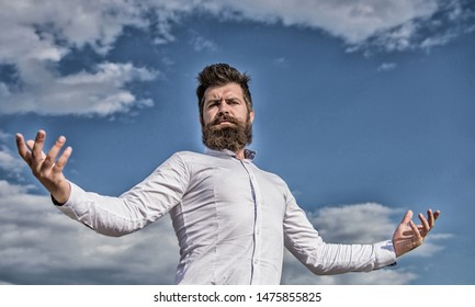 Self proud feeling. Hipster beard and mustache looks attractive white shirt. Guy enjoy top achievement. Superiority and power. Man bearded hipster formal clothes feels proud of himself sky background.