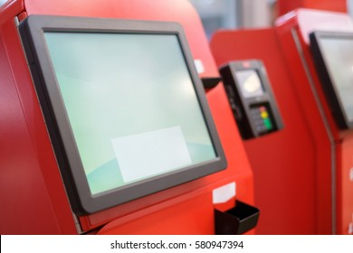 Self service cash desk with screen and card payment terminal in red in modern supermarket