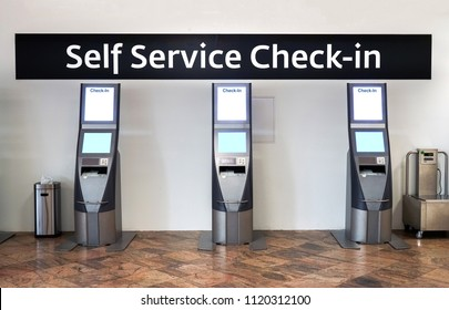 Self service check-in kiosks at International Airport for passenger. Close up of blank screen electronic self check-in kiosk in main terminal.