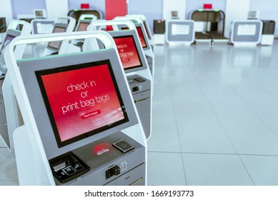 Self service electronic boarding pass readers at international airport. Self check-in machine. Printing bag tags for passengers