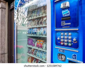 Self Service Machine selling Condoms and Free Medical Drugs out of a Pharmacy Shop in Milan,Italy-November 2018