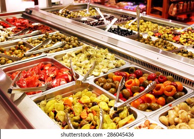 Self service salad bar with a variety of salads and side dishes
