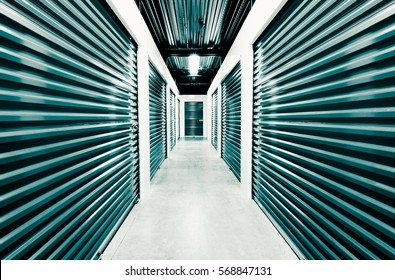 Self storage doors. Life style, storage, moving, storing, organizing concept. Grungy background, black and white post processed