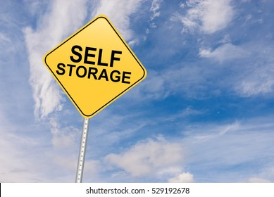 Self Storage Road Sign against sky