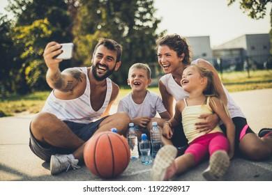Self time. Family on playground taking self portrait.
