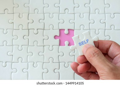 'self' written on a puzzle piece