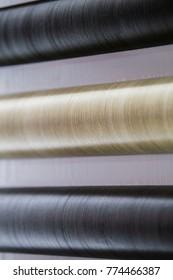 Self-adhesive paper, film, building material in rolls for furniture.