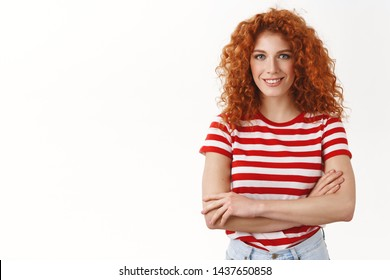 Self-assured attractive young redhead curly enthusiastic girl starting up new project feel determined enouraged success cross arms chest smiling assertive powerful women concept, white background