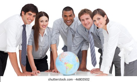 Self-assured business team around a terrestrial globe against a white background