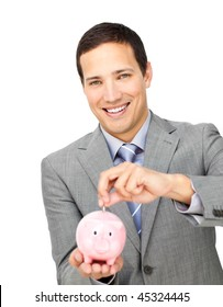 Self-assured businessman saving money in a piggy-bank against a white background
