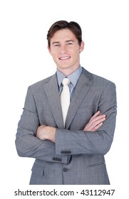 Self-assured businessman standing with folded arms in front of the camera