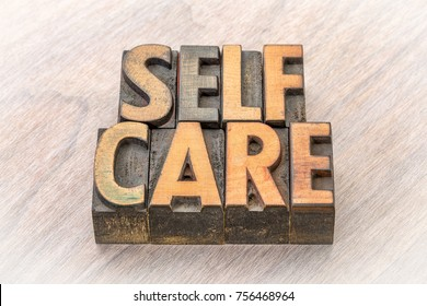 self-care word abstract in vintage letterpress wood type