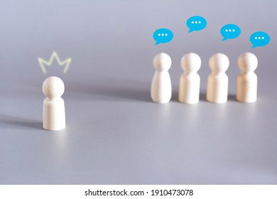 The self-confident boss has put on crown, the domineering leader in team. Managers discuss his behavior. Microclimate in labor collective office. Success in business concept