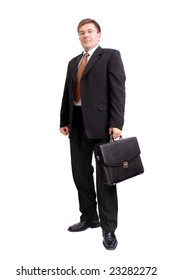 Self-confident businessman in black suit and white shirt posing with black briefcase over white background