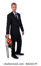 Self-confident businessman with chainsaw