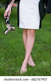 Self-confident girl walking without shoes. Barefoot unrecognizable woman with tired legs closeup, modern social behavior
