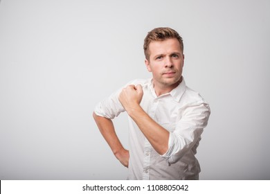 Self-confident middle aged man in white shirt with a clenched fist. I can do it concept.