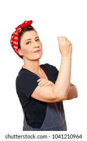 Self-confident middle aged woman with dungarees isolated on white background, text space, tribute to american worker icon Rosie Riveter