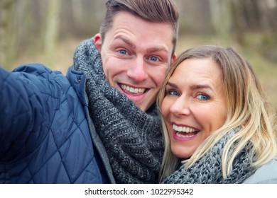 selfie of beautiful young couple outdoors in the cold