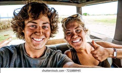 Selfie of best friends couple making adventure experience in Hawaii. Boyfriend and girlfriend smiling with dirty faces after a safari tour. Concept of amazing travelling with incredible holiday