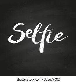 Selfie. Conceptual handwritten phrase. Hand lettered calligraphic design. Brush typography for poster, t-shirt or cards. illustration on chalkboard.