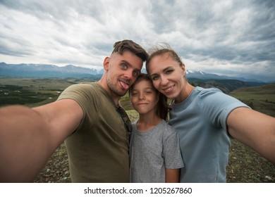 Selfie of family in mountain, beauty summer landcape