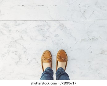 Selfie of feet in fashion leather flat shoes on pavement background, top view and copy space, social distancing keep distance in public