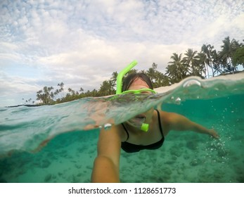 Selfie of a female woman tourist snorkelling at a beach at Matautu, Lefaga, Upolu Island, Western Samoa, South Pacific