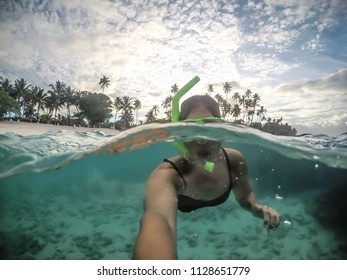 Selfie of a female woman tourist snorkelling at tropical beach at Matautu, Lefaga, Upolu Island, Western Samoa, South Pacific