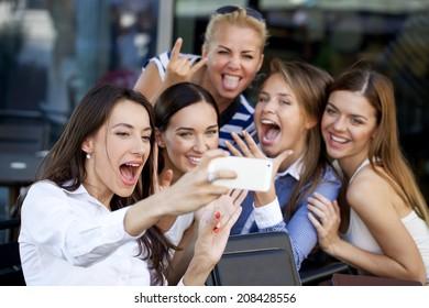 Selfie Five women sitting in a cafe on the street