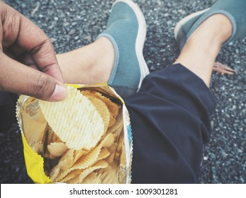 Selfie of hand with potato chips