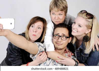 Selfie. Happy smiling young group looking at camera. isolated on white background.