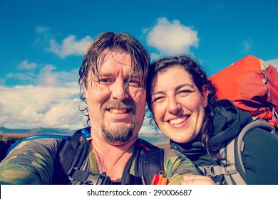 Selfie of hiking couple in the outdoors with filters applied for hipster look