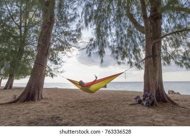 Selfie inside the hammock in the beautiful beach on sunny day.