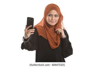 Selfie Muslim girl in action