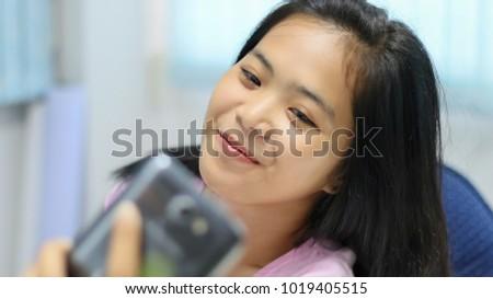 Young asian teen girl self authoritative