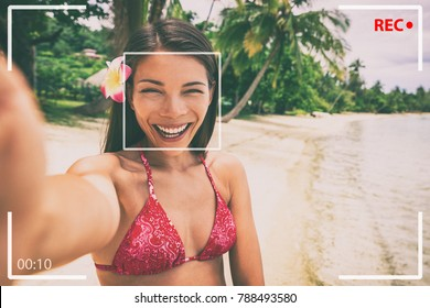 Selfie photo on beach Asian woman taking video recording on travel holiday in luxury Bora Bora island Tahiti vacation. Girl tourist vlogging online while traveling for social media.