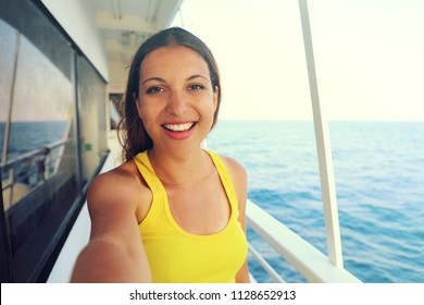 Selfie photo of young model woman on luxury travel cruise vacation in yellow dress enjoying the evening on Amalfi Coast getaway holidays. Happy traveler vacations in Italy. Vintage filter. Copy space.